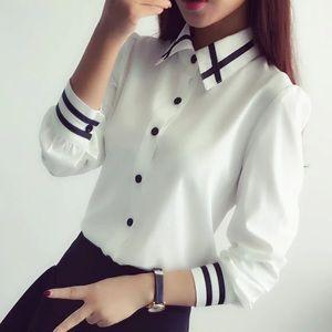 Elegant white button down top with black detail